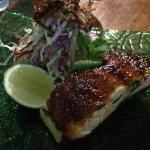 Palm sugar caramel baked Atlantic salmon with crispy potato gratin, green papaya and coconut sal