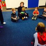 Paige with children playing pass the parcel