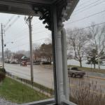 A view from the screened porch overlooking the street and water
