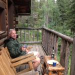 Relaxing on the deck at Rainbow Cabin