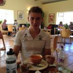 Henry tucking into soup, sandwiches, tea, coke and a rocky-road for the 27 miles cycle back to C