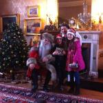 Father Christmas, Kids and Elf by the tree