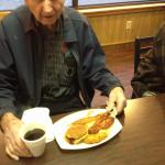 Mr. J.C. starts his day off right with the full breakfast and his friends reserve his favorite c