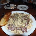 Galway City pasta with cavatappi, corned beef, mushrooms, carmelized onions covered in bourbon c