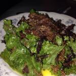 Warm mustard green salad with pig ear.