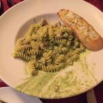 Fusilli pasta with pesto and chicken.