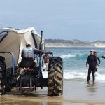 launching the RIB by tractor, then a lot of pushing in the surf. Fun!