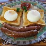 Sausages and eggs on toast