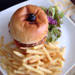 Meaty tuna burger with chips & salad!