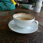 A half-drunk caffe latte