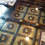 Close-up of glass-covered table, a work of art!