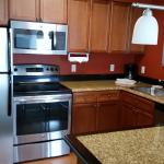 Full kitchen with dishwasher, dishes, fridge, microwave, stove & oven