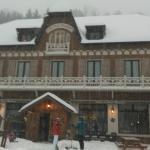Snow covered auberge la douce montagne