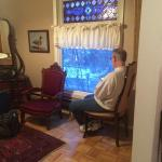 Sitting area by picture window with stained glass and lovely wood parquet floors. Beautiful!