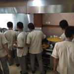 Preparing the infamous ikan kepala gulai
