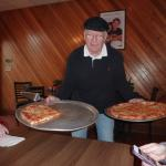 Richard Serving Pizza