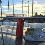 Enjoying a sandwich next to the marina