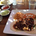 Poblano chiles with chicken mole, red rice, secret ingredient red pinto beans and queso fresco