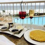 Cocktails and waffles with an ocean view