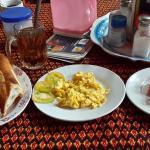 Bread with scramble egg + tea + fruits