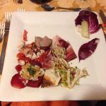 Antipasto misto: insalata di pesce, speck con noci tritate, bresaola porcini e grana, roast beef