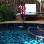 Grandson playing pool-boy