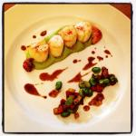 Scallops on pea purée