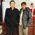 A snap shot with Konggang hotel's manager.