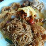 Noodles, squid, omelet with sweet potato fillings, beef and chicken. The veggie curry is delicio