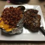 Large Sirloin $21.99 and Loaded Baked Potato $4.99 upcharge for steak dinner. Pricey but easily