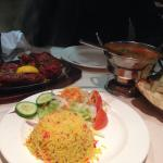 Mixed grill, served with curry, rice, naan and salad