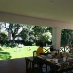 Enjoying breakfast on the terrace as the children play in the garden