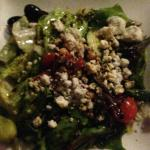 attractive side salad with crumbly blue balsamic dressing