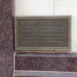"""""""Editors Building"""" plaque on the front exterior of the hotel"""