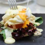 jumbo lump crab, english muffin, tomato, mesclun salad and doused with hollandaise sauce