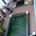 view from terrace onto pool below