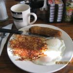 Eggs over easy, country link and crisp hash browns. Mad Yummy!
