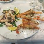 Mixed seafood grill. Langoustines, king prawns, and squid