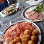 Fried gnocchi with prosciutto and cooked salami.