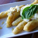 Fried dough topped with creamy marscappone, honey and hand whipped cream