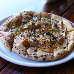 "Pane 11"" round bread, garlic, EVOO, sea salt, Parmigiano Reggiano, oregano and balsamic glaze"