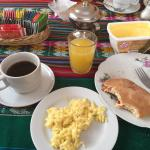 Scrambled eggs, tea/coffee, fresh bread and strawberry jam, freshly squeesed oj also. ��