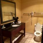 Clean bathroom with heat lamp and hair dryer