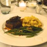 Filet Mignon with red wine mushroom dem-glace with garlic mashed potatoes & haricot vert.