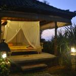 The daybed for all guests near the pool overlooking the ocean at twilight