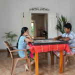 Playing carrom at the Dream Palace