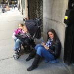 My hot wife and kids waiting for her hot coffee and toasted egg bagel outside of store. Worth th