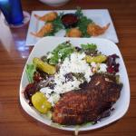 Greek salad with blackened grouper, coconut shrimp in the background. Outstanding!