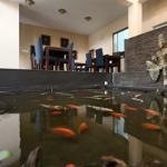 fish pond in foyer area