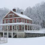 The Rock Ford mansion blanketed in snow during Yuletide tours.